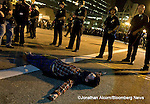 A protester lies in the middle of 1st St at Occupy L.A. after the deadline to dismantle their tent city passed without being enforced in Los Angeles, California, U.S., on Monday, November 28, 2011.