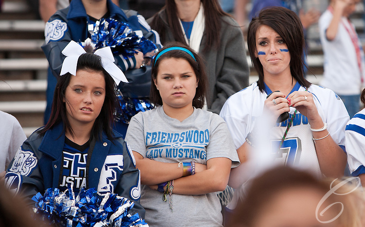 Friendswood  fans react as they watch the final seconds of the Mustangs loss to the Lake Travis Cavaliers.  The Mustangs' lost 24 - 3 at Kyle Field on December 11, 2010 in the Class 4A, D-1 state semifinals.