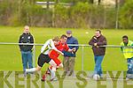 Dynamos Edward Duggan and Fingal's Kevin Boyd.