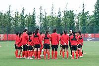 14th May 2020, Suzhou, southeastern Jiangsu Province of East China;  Jia Xiuquan, head coach of Chinas womens national football team instructs players during an open training session in Suzhou