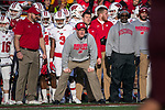 Wisconsin Badgers Head Coach Paul Chryst, center, looks on from the sidelines during an NCAA College Big Ten Conference football game against the Minnesota Golden Gophers Saturday, November 25, 2017, in Minneapolis, Minnesota. (Photo by David Stluka)
