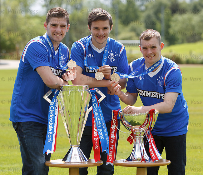 Kyle Hutton, Jamie Ness and Gregg Wylde with the SPL and League Cup trophies and SPL winners medals