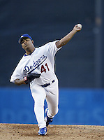 Odalis Perez of the Los Angeles Dodgers pitches during a 2002 MLB season game at Dodger Stadium, in Los Angeles, California. (Larry Goren/Four Seam Images)