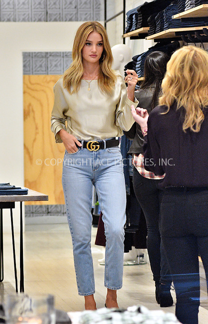 www.acepixs.com<br /> <br /> September 16 2016, New York City<br /> <br /> Model Rosie Huntington-Whiteley went shopping in Soho on September 16 2016 in New York City<br /> <br /> By Line: Curtis Means/ACE Pictures<br /> <br /> <br /> ACE Pictures Inc<br /> Tel: 6467670430<br /> Email: info@acepixs.com<br /> www.acepixs.com