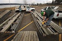 Workers repair boat and fishing docks for Hoover Reservoir in Columbus,  Some of the board replaced were more than 30 years old.Ohio.