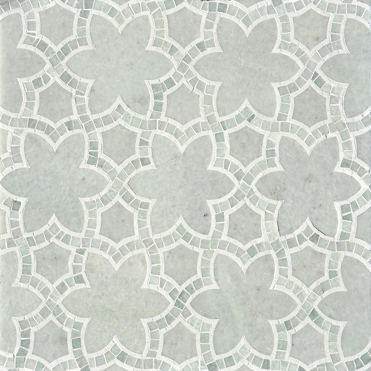 Reina, a waterjet and hand-cut mosaic shown in polished Ming Green and Thassos, is part of the Miraflores collection by Paul Schatz for New Ravenna.