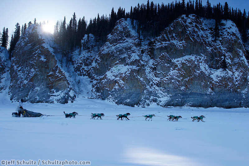 Saturday  March 13 , 2010   Quinn Iten runs on the Yukon River next to cliffs after leaving the village checkpoint of Ruby