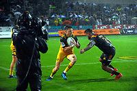Beauden Barrett runs at Hika Eliiot during the Super Rugby match between the Chiefs and Hurricanes at FMG Stadium in Hamilton, New Zealand on Friday, 10 March 2017. Photo: Dave Lintott / lintottphoto.co.nz