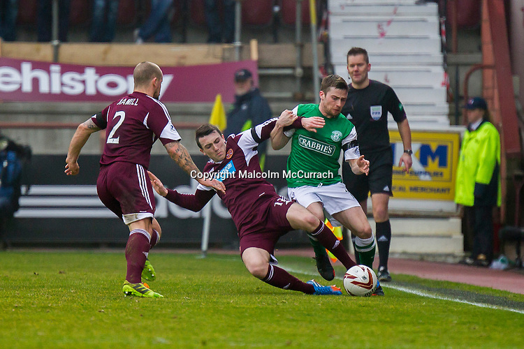 Hearts v Hibs at Tynecastle Stadium, Edinburgh. Sun, 30, March, 2014.<br /> <br /> Pictured: David Smith keeps control of the ball from Lewis Stevenson<br /> <br /> Image by: Malcolm McCurrach