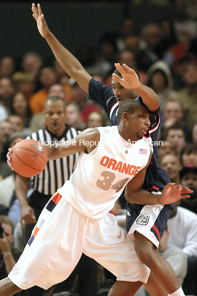 NEW YORK, NY--07 MARCH 2007--030707JS15-UConn's Marcus Johnson gest called for a foul while guarding Syracuse's Demitris Nichols during their Big East tournament game Wednesday at Madison Square Garden in New York City. UConn lost 78-65.<br /> Jim Shannon / Republican-American