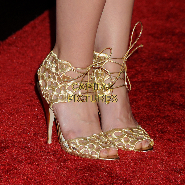 JAYMA MAYS' shoes .Attending the 12th Annual Costume Designers Guild Awards held at the Beverly Hilton Hotel.  .Beverly Hills, California, USA,  .25th February 2010 .arrivals detail gold shoes sandals open tie lace-up peep toe feet .CAP/ADM/BP.©Byron Purvis/AdMedia/Capital Pictures.