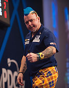 01.01.2014.  London, England.  William Hill PDC World Darts Championship.  Quarter Final Round.  Peter Wright (5) [SCO] celebrates a finish during his game with Gary Anderson (4) [SCO].