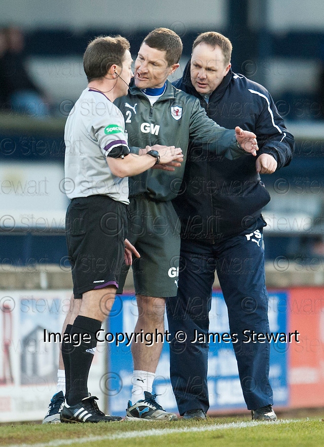 Referee Crawford Allan explains his decision to send off Allan Walker to Raith Rovers' manager Grant Murray ...