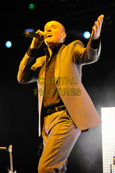 HEAVEN 17- Glenn Gregory.Heaven 17 performs on stage at HMV Forum, London, England. .November 28th, 2010.stage concert live gig performance music half length brown beige suit 3/4 singing hand arm.CAP/MAR.© Martin Harris/Capital Pictures.