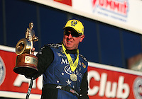 Nov 13, 2016; Pomona, CA, USA; NHRA funny car driver Tommy Johnson Jr celebrates after winning the Auto Club Finals at Auto Club Raceway at Pomona. Mandatory Credit: Mark J. Rebilas-USA TODAY Sports