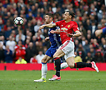 Zlatan Ibrahimovic of Manchester United tackled by Gary Cahill of Chelsea during the English Premier League match at Old Trafford Stadium, Manchester. Picture date: April 16th 2017. Pic credit should read: Simon Bellis/Sportimage