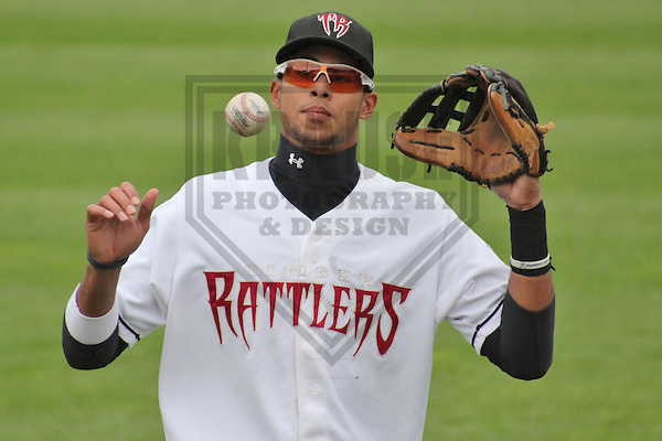 GRAND CHUTE - September 2012: Yadiel Rivera (13) of the Wisconsin Timber Rattlers, Class-A affiliate of the Milwaukee Brewers, prior to a playoff game against the Fort Wayne TinCaps on September 13, 2012 at Time Warner Cable Field at Fox Cities Stadium in Grand Chute, Wisconsin. Fort Wayne defeated Wisconsin 5-1 to tie the series at 1-1 in the best of 5 Midwest League Championship Series. (Photo by Brad Krause). ..