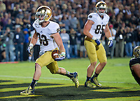 Running back Cam McDaniel (33) bursts through the line of scrimmage for Notre Dame's first touchdown.