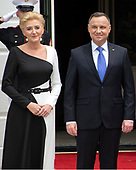 President Andrzej Duda of the Republic of Poland, right, and his wife, Agata Kornhauser-Duda, left, as they are welcomed by United States President Donald J. Trump and first lady Melania Trump to the South Lawn of the White House in Washington, DC on Wednesday, June 12, 2019. <br /> Credit: Ron Sachs / CNP