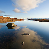 Reflection in lochan, Black Cuillin hills, Glenbrittle, Isle of Skye, Scotland