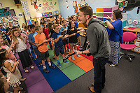 """NWA Democrat-Gazette/ANTHONY REYES • @NWATONYR<br /> Barrett Baber, of Fayetteville, works with a combined fourth grade choir Wednesday, Sept. 23, 2015 at Vandergriff Elementary School in Fayetteville. Baber is a contestant on the NBC show """"The Voice."""" Baber is working with the students on a song he co-wrote, """"A.R.K.A.N.S.A.S. (Get there from here)"""" that won a contest with the Arkansas Department of Parks and Tourism. The choir and Barber will have a special performance for the school on Oct. 5 and a public performance the same day at 6:30 p.m. in the Vandergriff gym."""