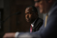 United States Secretary of Housing and Urban Development (HUD) Ben Carson, center, listens to questions of U.S. Senators on Capitol Hill in Washington, D.C., June 9, 2020, during a hearing of the U.S. Senate Committee on Banking, Housing, and Urban Affairs to examine housing regulations during the pandemic. <br /> Credit: Astrid Riecken / Pool via CNP/AdMedia