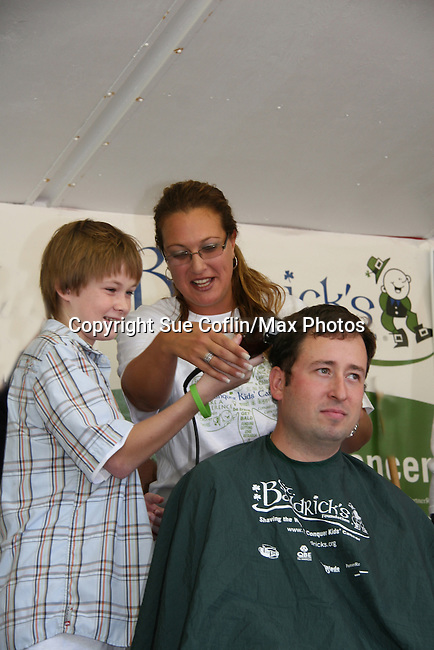 "One Life To Live's Austin Williams ""Shane"" donated his day as a supporter and barber and here shaves Chris on August 30, 2009 at the St. Baldrick's Foundation Rundraising Head Shaving event to help raise money for Childhood Cancer Research at the Cresskill Fire Department in Cresskill, NJ. Austin's grandfather Bob was diagnosed with Lymphoma at the same time Austin aired with cancer on OLTL. His grandfather was treated and seems to have beaten the disease. (Photo by Sue Coflin/Max Photos?"