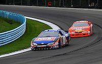 Aug. 8, 2009; Watkins Glen, NY, USA; NASCAR Nationwide Series driver Kyle Busch (18) leads Marcos Ambrose (47) during the Zippo 200 at Watkins Glen International. Mandatory Credit: Mark J. Rebilas-