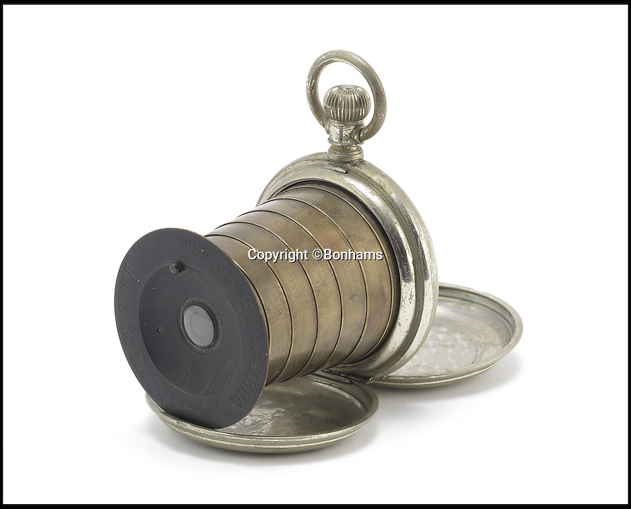 BNPS.co.uk (01202 558833)Pic: Bonhams/BNPS<br /> <br /> The Watch Camera, 1894. Estimate &pound;34,000 - &pound;51,000.<br /> <br /> An incredible archive of rare vintage spy cameras that would rival James Bond's own collection has emerged for sale for a staggering &pound;400,000.<br /> <br /> The Heath Robinson-style cameras date from the 1880s and come in numerous wacky guises including a book, a wristwatch, a packet of cigarettes, binoculars and even a handgun.<br /> <br /> Many of the ingenious devices were commercial failures and so very few were made, making surviving examples worth tens of thousands of pounds now.<br /> <br /> The collection will be sold at London auctioneers Bonhams on December 3.