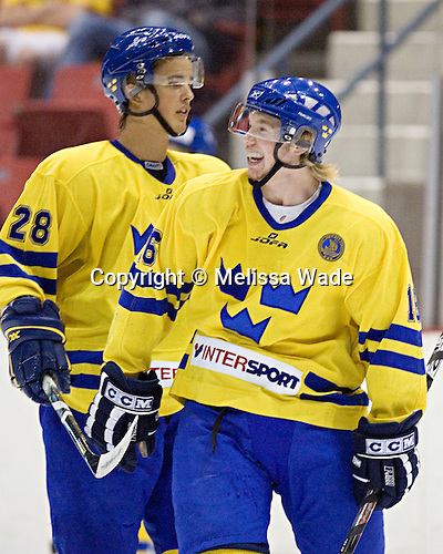 Robin Figren 16 of Sweden (Niklas Hjalmarsson 28 of Sweden) enjoys a laugh. Team Sweden defeated Team USA Blue 4-3 by winning the shootout on Saturday, August 12, 2006, at the 1980 Rink in Lake Placid, New York in their final game of the US Under-20 Training Camp and Summer Hockey Challenge.
