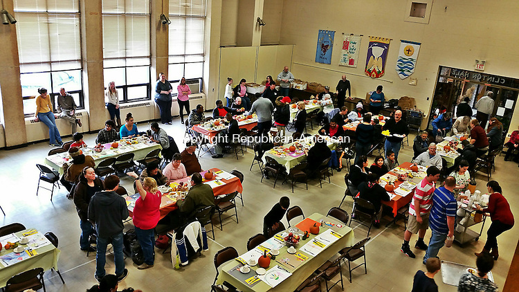 WATERBURY -- Nov. 27, 2015 -- 26_NEW_112715MDP03 -- First Congregational Church was filled with needy diners at the annual Thanksgiving feast hosted by Greater Waterbury Interfaith Ministries (GWIM) Thursday.