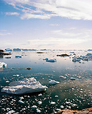 GREENLAND, Ilulissat, iceberg and fishing boat in Disco Bay
