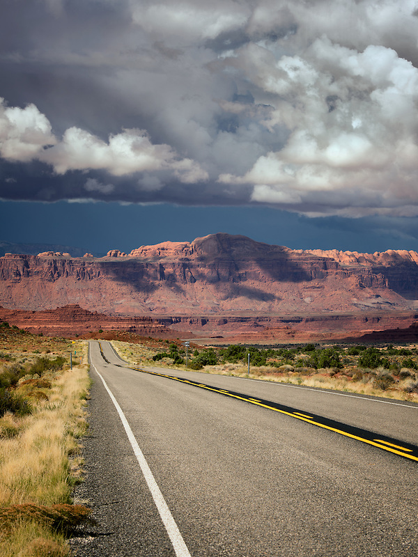 Road and mountains with storm clouds. Scenic Byway Hwy 95, Glen Canyon National Recreation Area, Utah