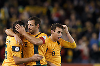 MELBOURNE, 11 JUNE 2013 - Mark MILLIGAN and Lucas NEILL of Australia celebrate their win in a Round 4 FIFA 2014 World Cup qualifier match between Australia and Jordan at Etihad Stadium, Melbourne, Australia. Photo Sydney Low for Zumapress Inc. Please visit zumapress.com for editorial licensing. *This image is NOT FOR SALE via this web site.
