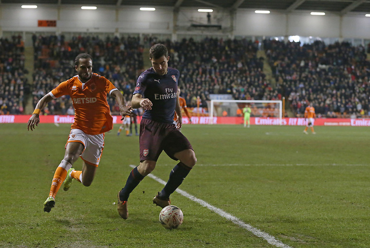 Arsenal's Sokratis Papastathopoulos shields the ball from Blackpool's Nathan Delfouneso<br /> <br /> Photographer Stephen White/CameraSport<br /> <br /> Emirates FA Cup Third Round - Blackpool v Arsenal - Saturday 5th January 2019 - Bloomfield Road - Blackpool<br />  <br /> World Copyright &copy; 2019 CameraSport. All rights reserved. 43 Linden Ave. Countesthorpe. Leicester. England. LE8 5PG - Tel: +44 (0) 116 277 4147 - admin@camerasport.com - www.camerasport.com