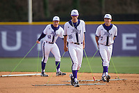 Drew Daczkowski (16), Garrett Letchworth (7), and Grey Lyttle (42) drag the infield between innings of the game against the NJIT Highlanders during game one of a double-header at Williard Stadium on February 18, 2017 in High Point, North Carolina.  The Panthers defeated the Highlanders 11-0.  (Brian Westerholt/Four Seam Images)