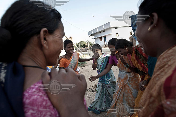 Women dance at a microfinance group meeting in Boilakunta village near Mahabubnagar.