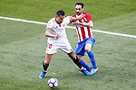 Atletico de Madrid's Juanfran Torres (r) and Sevilla FC's Vitolo during La Liga match. March 19,2017. (ALTERPHOTOS/Acero)