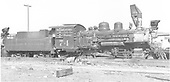 Engineer's-side view of C&amp;S #74 stored for scrapping at Morse Bros. Scrap Yard in Denver.<br /> C&amp;S  Morse Bros. Scrap Yard, Denver, CO  Taken by Ward, Bert H. - 7/17/1946