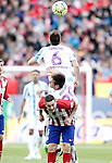 Atletico de Madrid's Koke Resurrecccion (d) and Malaga CF's Ignacio Camacho (t) and Duje Cop during La Liga match. April 23,2016. (ALTERPHOTOS/Acero)