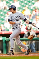 J.T. Chargois #14 of the Rice Owls follows through on his swing against the Baylor Bears at Minute Maid Park on March 6, 2011 in Houston, Texas.  Photo by Brian Westerholt / Four Seam Images