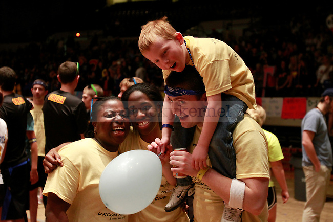 Dancers and a child pose for a picture at DanceBlue on March 3, 2012 in Memorial Coliseum.