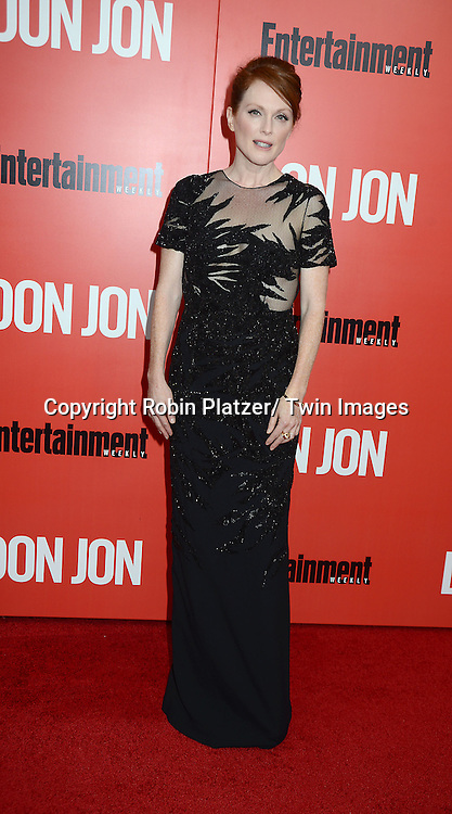 "Julianne Moore in black Jason Wu dress attends the ""Don Jon"" New York Movie Premiere on September 12, 2013 at the SVA Theatre in New York City."