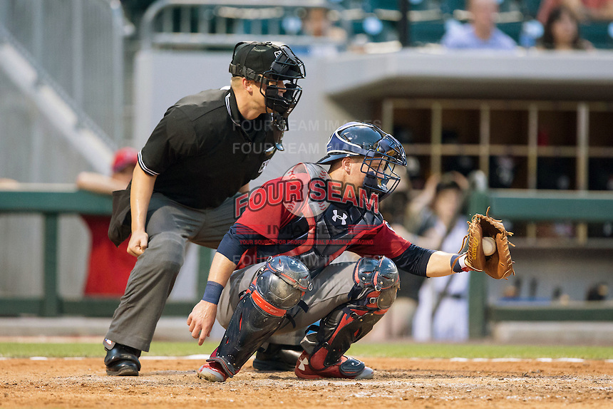 Lehigh Valley Iron Pigs catcher Andrew Knapp (15) frames a pitch as home plate umpire Chris Segal looks on during the game against the Charlotte Knights at BB&T BallPark on June 3, 2016 in Charlotte, North Carolina.  The Iron Pigs defeated the Knights 6-4.  (Brian Westerholt/Four Seam Images)