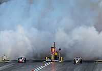Mar 28, 2014; Las Vegas, NV, USA; A pair of NHRA jet car drivers launch off the starting line during qualifying for the Summitracing.com Nationals at The Strip at Las Vegas Motor Speedway. Mandatory Credit: Mark J. Rebilas-USA TODAY Sports