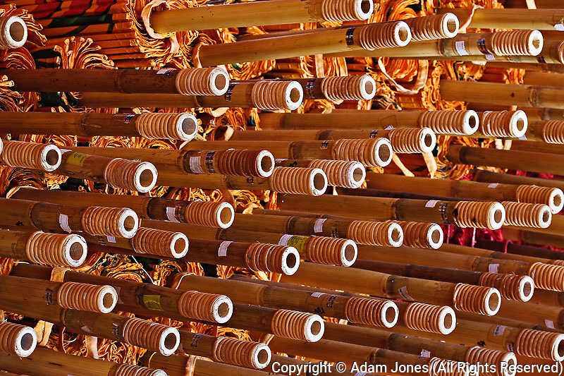Stack of ubrella handles awaiting final assembly, Bosang, Chiang Mai,.Thailand