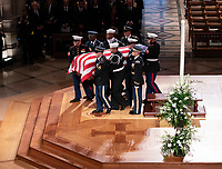 December 5, 2018 - Washington, DC, United States: A military casket team carries to casket of former President George W. Bush from the National Cathedral at the conclusion of his state funeral.  <br /> <br /> CAP/MPI/RS<br /> &copy;RS/MPI/Capital Pictures