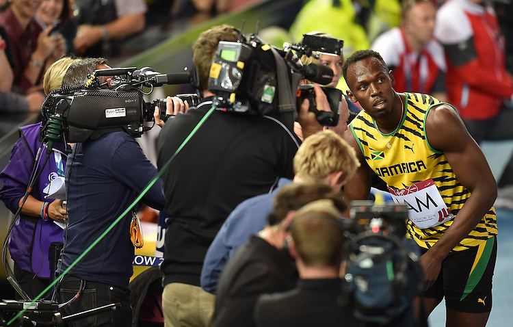 Jamaica's Usain Bolt speaks to the media after the men's 4x100m relay heat 2<br /> <br /> Photographer Chris Vaughan/CameraSport<br /> <br /> 20th Commonwealth Games - Day 9 - Friday 1st August 2014 - Athletics - Hampden Park - Glasgow - UK<br /> <br /> &copy; CameraSport - 43 Linden Ave. Countesthorpe. Leicester. England. LE8 5PG - Tel: +44 (0) 116 277 4147 - admin@camerasport.com - www.camerasport.com