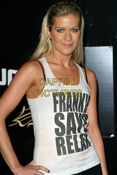 KATE LAWLER.Sound Bar, Restaurant & Nightclub - VIP launch party, London, UK..September 28th, 2006.Ref: AH.half length white tank top hand on hip frankie says relax.www.capitalpictures.com.sales@capitalpictures.com.©Adam Houghton/Capital Pictures.