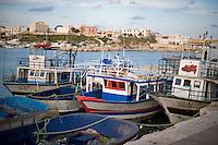 Alcune barche usate dai Tunisini per raggiungere Lampedusa ancorate nel porto prima di essere trasportate nel cimitero delle barche..The boat used by Tunisian immigrants arrived in Lampedusa.